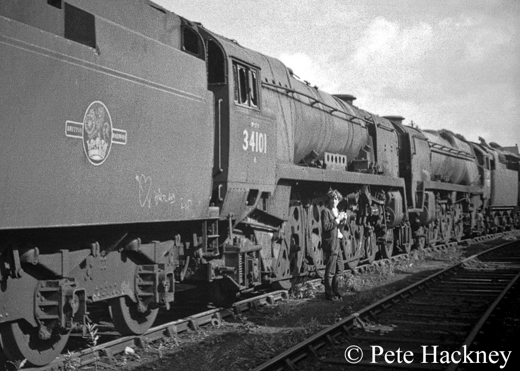 34101 Hartland and 35022 Holland America Line in Woodham's scrapyard at Barry - July 1968.jpg