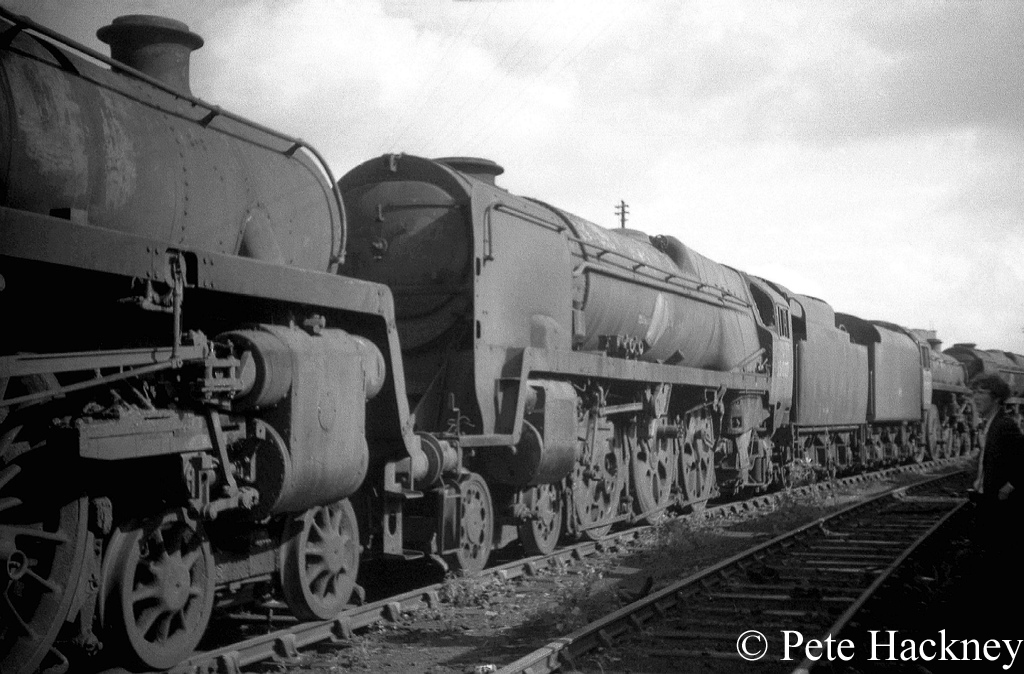 35027 Port line in Woodham's scrapyard at Barry. The locomotive in front of it is 75078 - July 1968