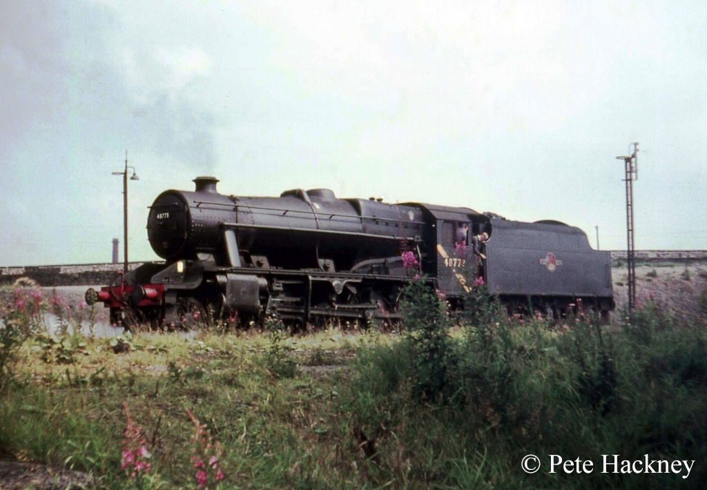 48773 at Rose Grove. It was the last working steam locomotive to have the yellow cab stripe indicating that it was barred from travelling south of Crewe. - 1st August 1968.jpg