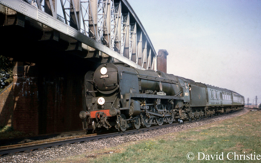 34059 Sir Archibald Sinclair heads under the flyover at Worting Junction on a train to Salisbury - September 1964.jpg
