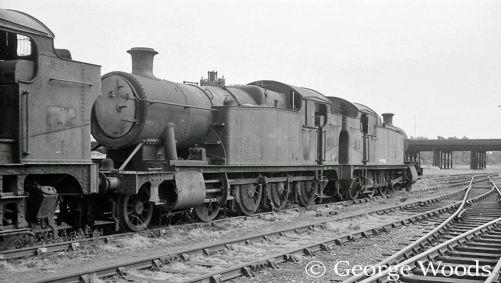 5227 next to 4253 in Wodham's scrapyard at Barry - June 1964.jpg