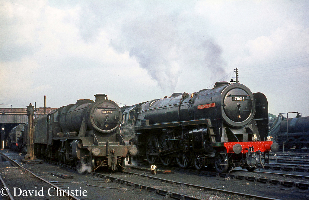 70013 Oliver Cromwell on Lostock Hall shed next to 8F class 48493 - 4th August 1968 .jpg