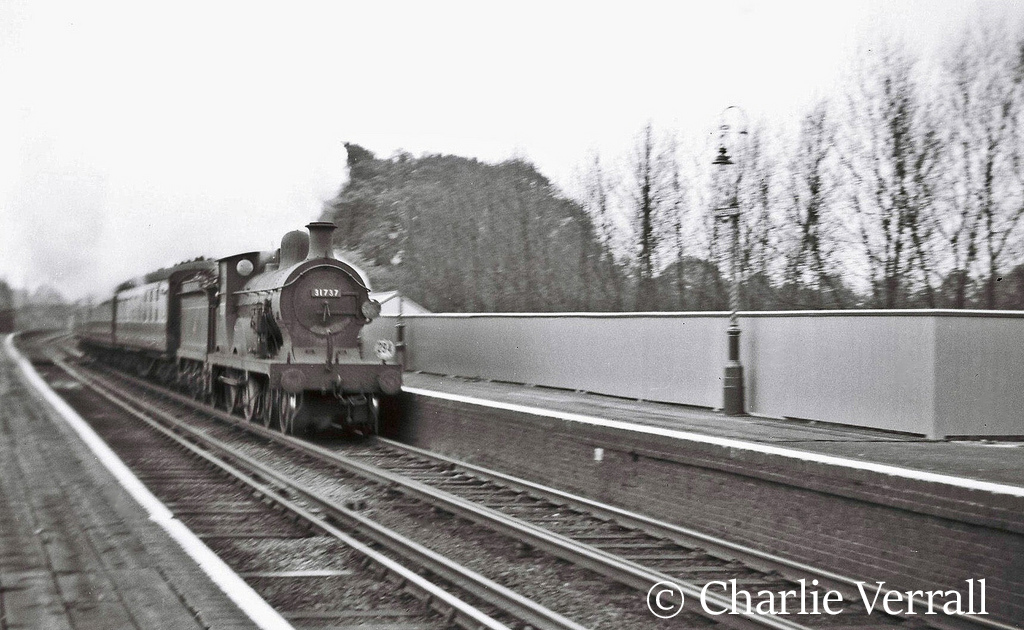 31737 passing Wivelsfield with the Hastings portion of a through train to Birkenhead - May 1955 .jpg