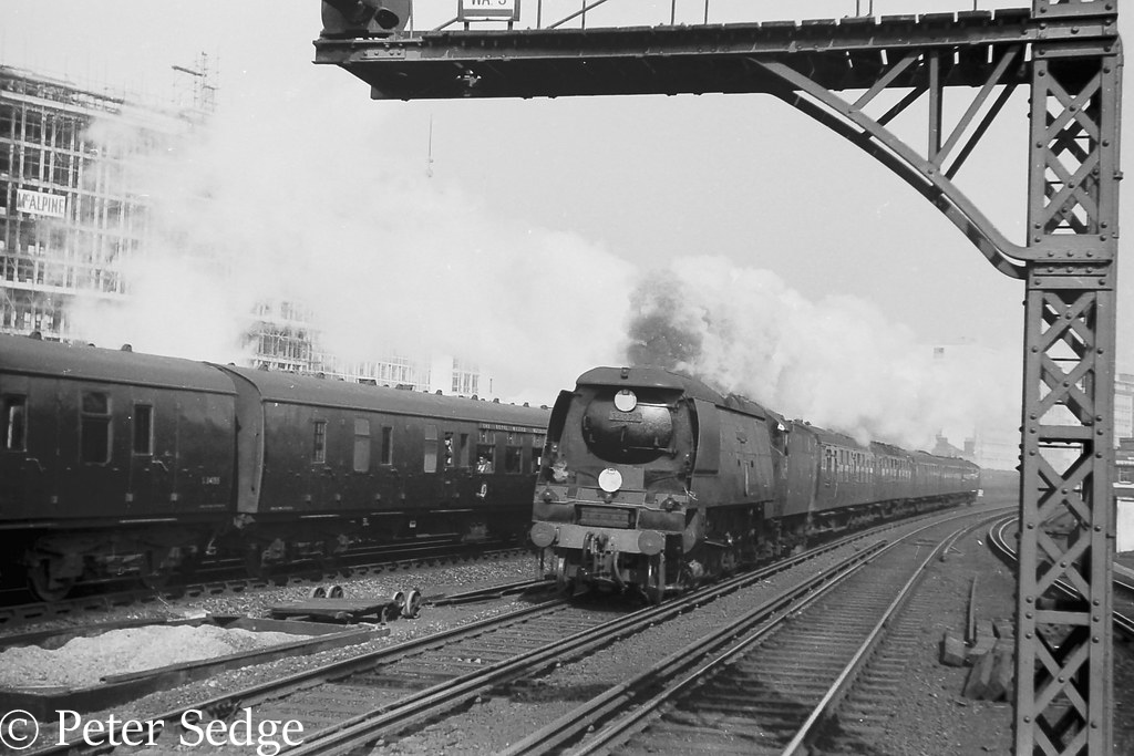 This image has an empty alt attribute; its file name is 34072-257-squadron-approaches-vauxhall-on-an-express-from-waterloo-may-1961.jpg