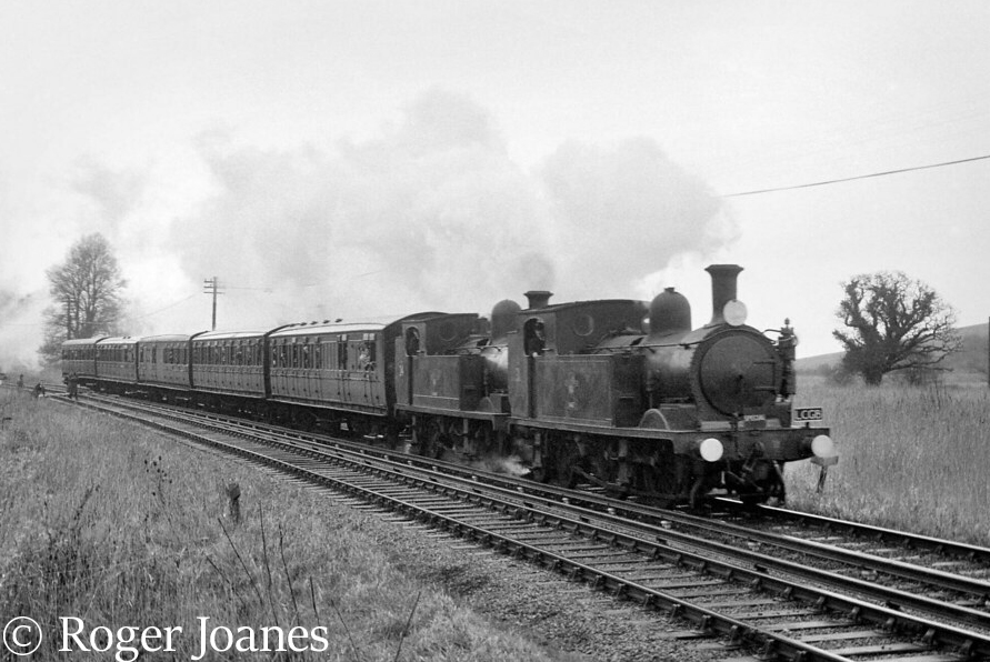 w24 double heads with w31 between brading and sandown with a special train for shanklin december 1966  - By underground to Shanklin